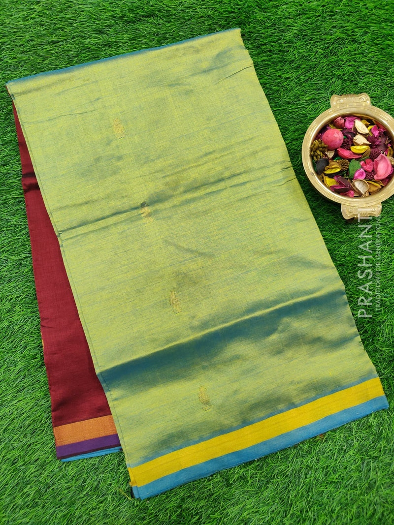 Semi silk cotton saree dual shade of green and maroon with golden zari buttas and zari border