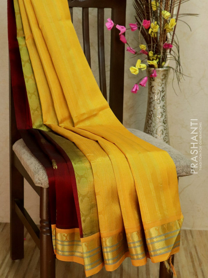 Silk Cotton Saree maroon and yellow korvai with traditional zari border and body buttas