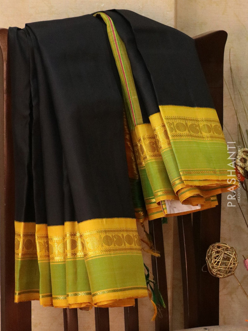 Pure Kanjivaram Silk Saree black and mustard yellow with plain body and golden zari rettapet border