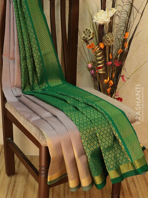 Silk cotton saree grey and green with golden zari temple border