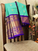 Kuppadam silk cotton saree teal green and violet with zari woven buttas and rich zari border