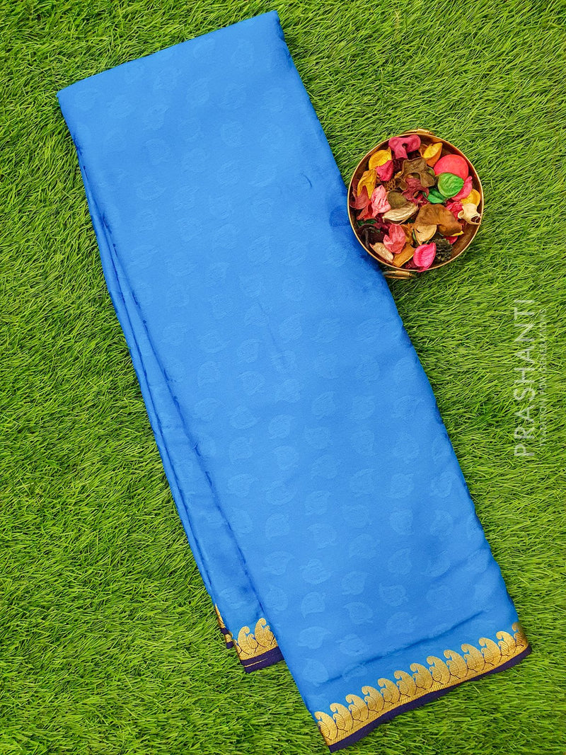 Semi Crepe saree cs blue and blue with self embose and golden zari border