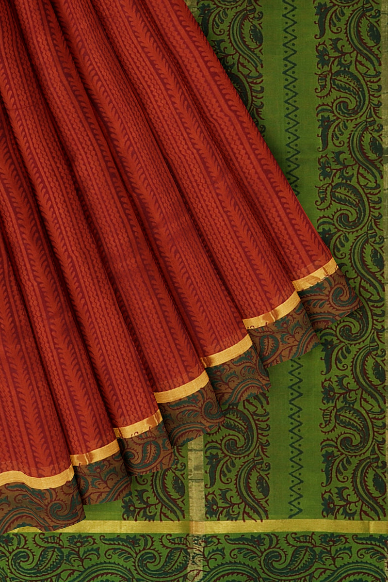 Silk cotton saree rust orange and green with floral lines hand block prints and simple zari border