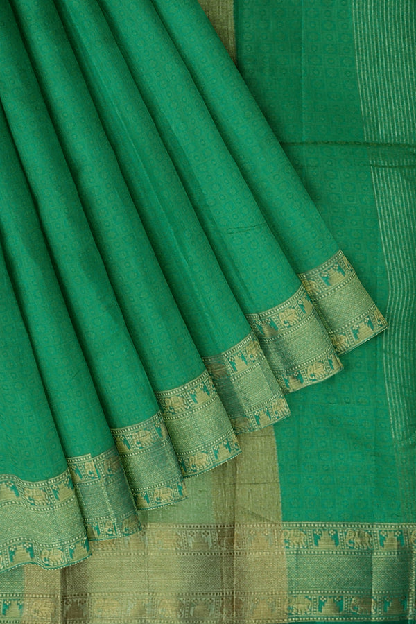Semi raw silk saree baby green with elephant and temple zari border and self embose pattern