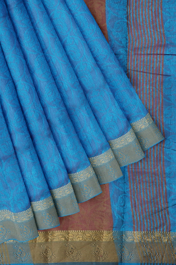 Semi raw silk saree copper sulphate blue with self embose pattern and thread and zari border