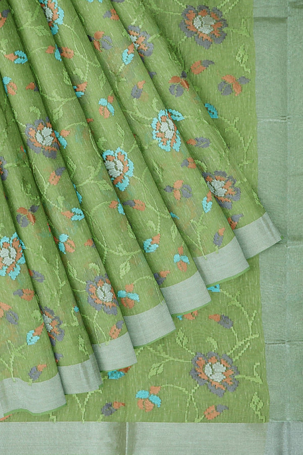 Linen Saree mild green with floral computerized embroidery and silver zari border