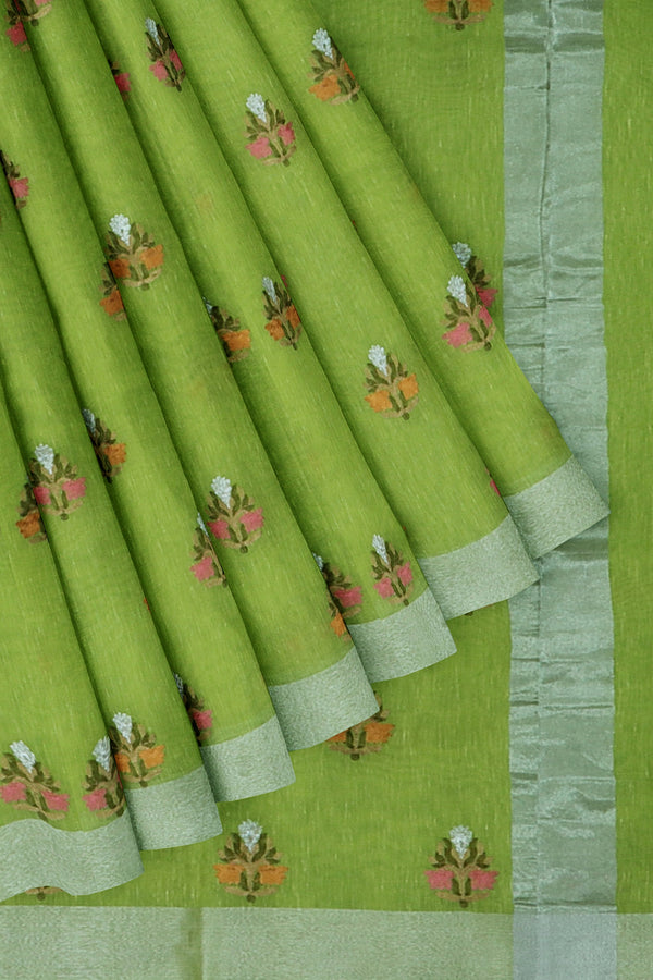 Linen Saree green with all over floral embroidery and silver zari border