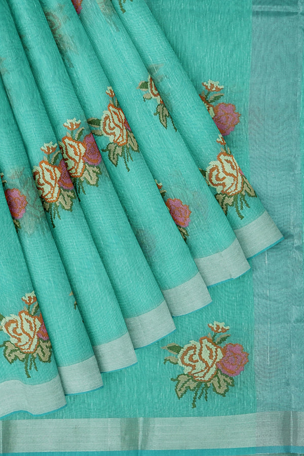 Linen Saree teal with floral embroidery and silver zari border