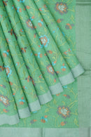Linen Saree light green with all over floral embroidery and silver zari border