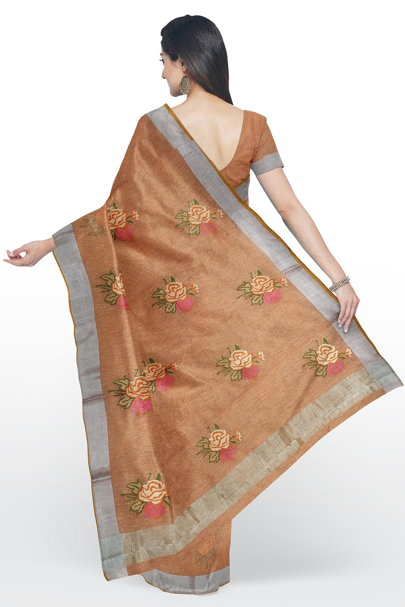 Linen Saree creamy orange with floral computerized embroidery and silver zari border
