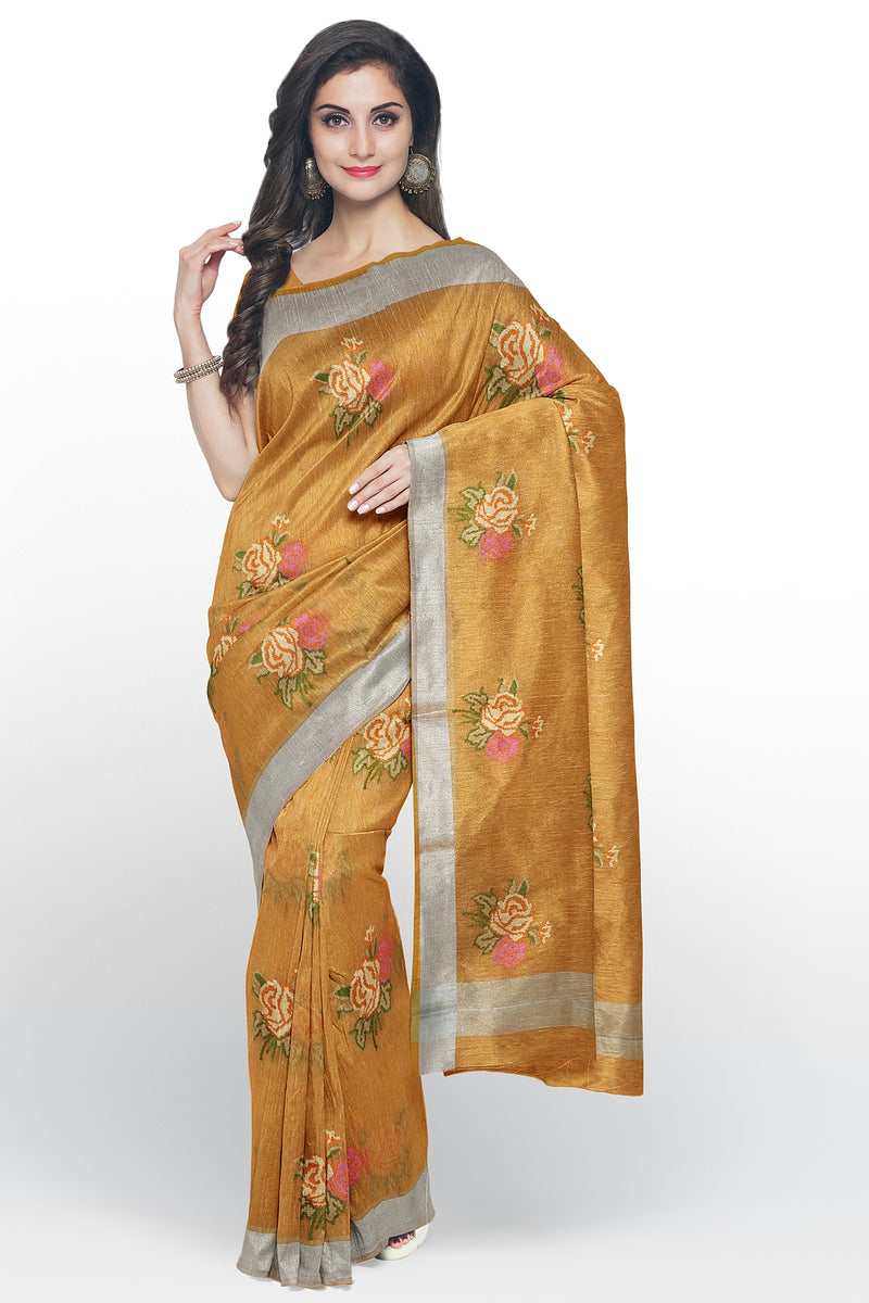 Linen Saree orange with all over floral embroidery and silver zari border