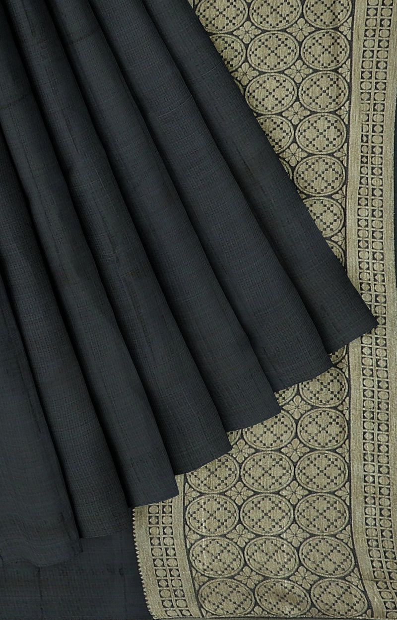 Semi raw silk saree black with self emboss and simple piping zari border