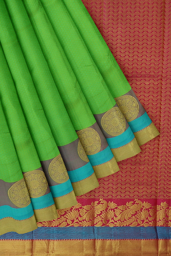 Pure kanjivaram silk saree parrot green with golden zari round floral buttas and self emboss