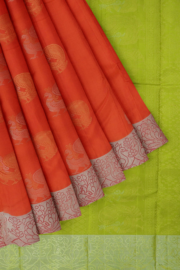 Soft Silk saree orange with silver zari border and peacock buttas