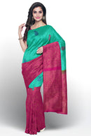 Pure Kanjivaram silk saree half and half teal green and pink with golden zari peacock design border