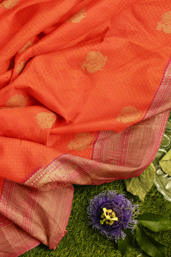Pure Kanjivaram silk saree orange and golden pink with golden emboss zari border and peacock buttas
