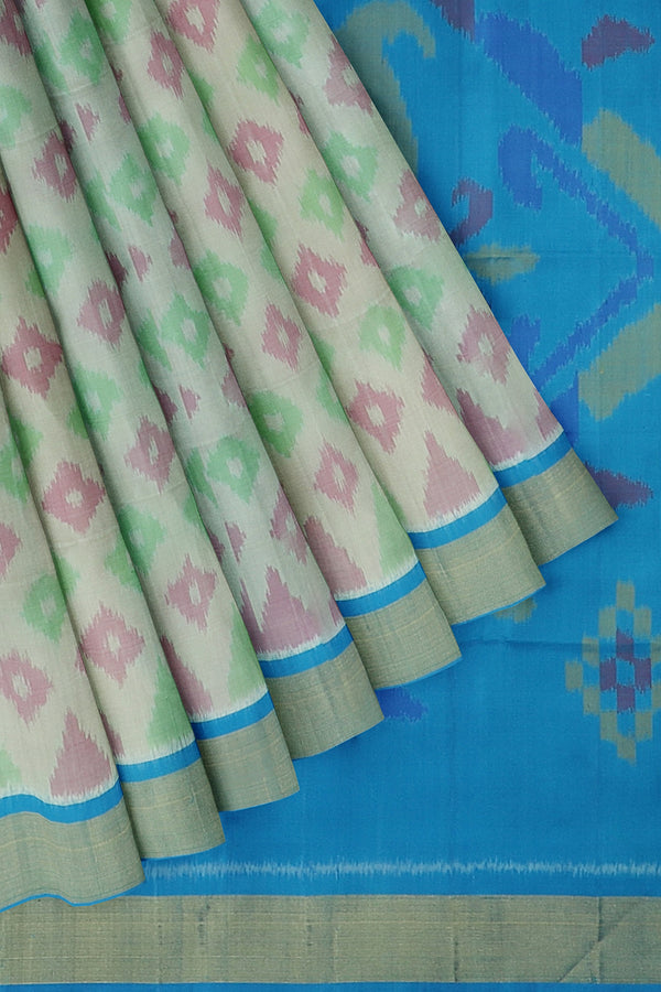 Ikkat soft silk saree half white and sky blue with golden zari border