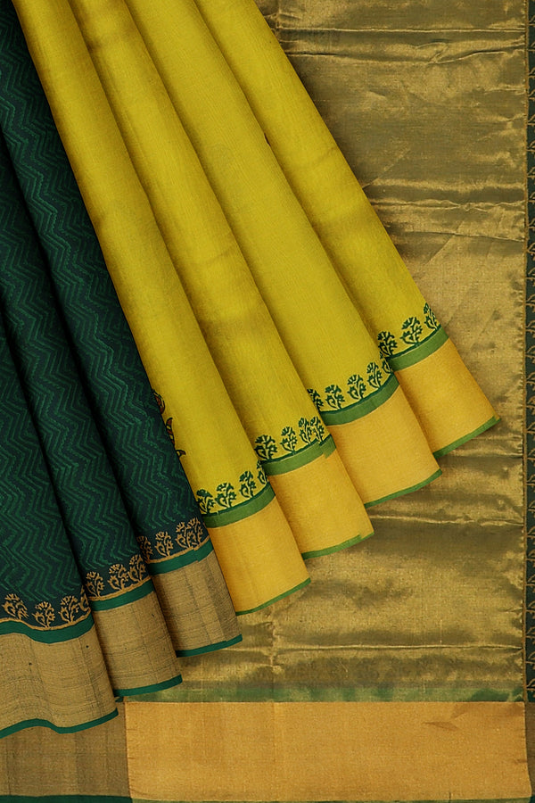 Hand block printed silk cotton partly saree yellow and bottle green with floral designs and zari border