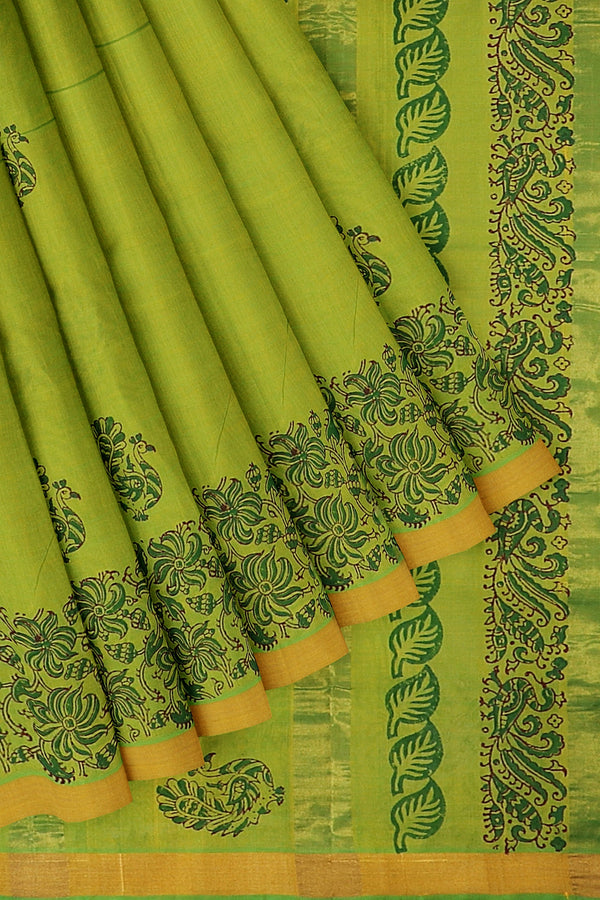 Hand block printed silk cotton saree dual shade of light green with floral desing in zari border