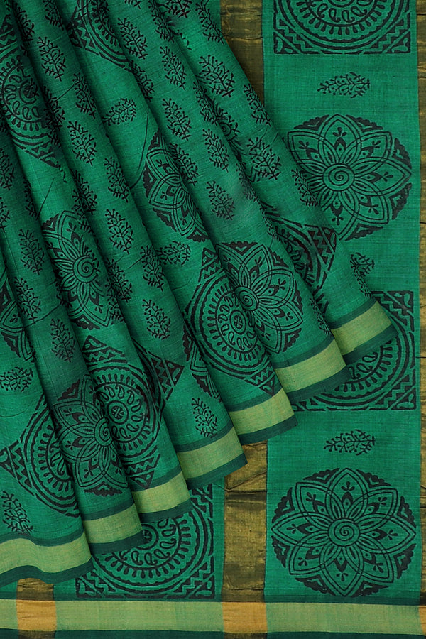 Hand block printed silk cotton saree green with leaf patten zari border