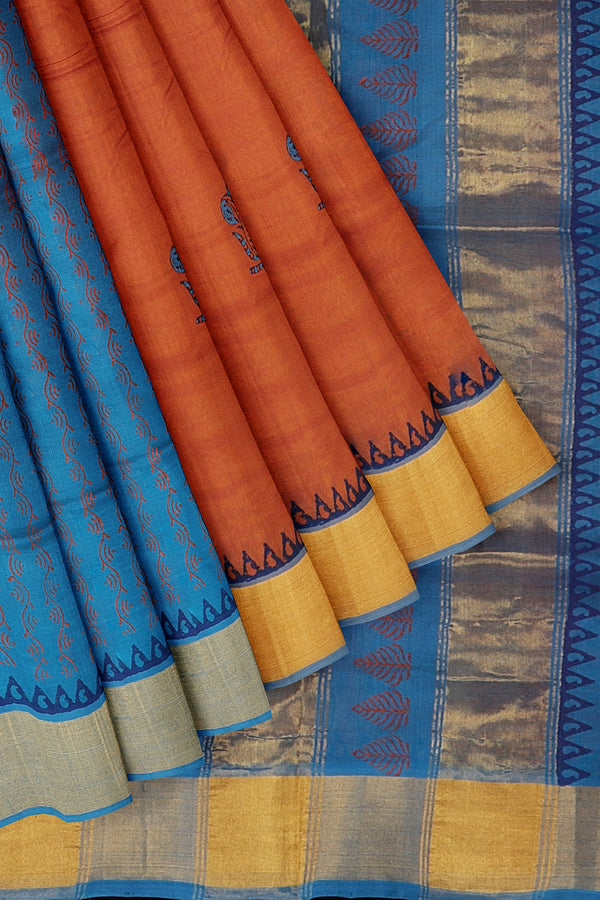 Silk cotton partly saree dual shade of rust and sky blue with peacock hand block prints with golden zari border