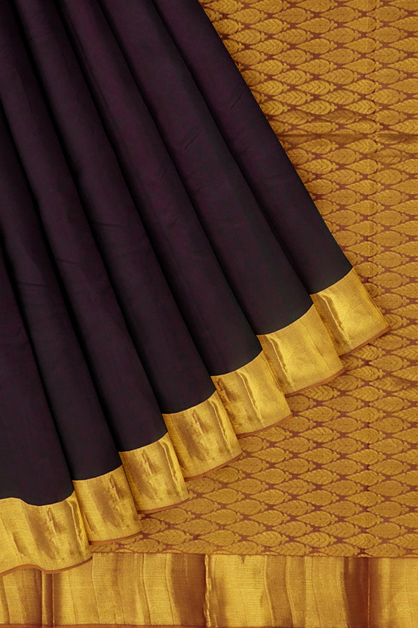 Kanjivaram silk saree dual shade of grape and golden shade with oveall self emboss and simple zari border