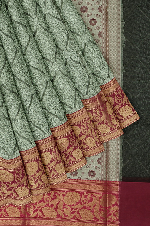 Banarasi Kora grey with oink self embose floral pattern with kanji style border
