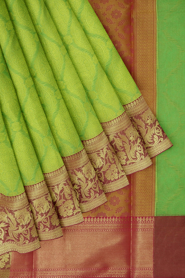 Banarasi Kora parrot green with pink self embose pattern with kanji style border
