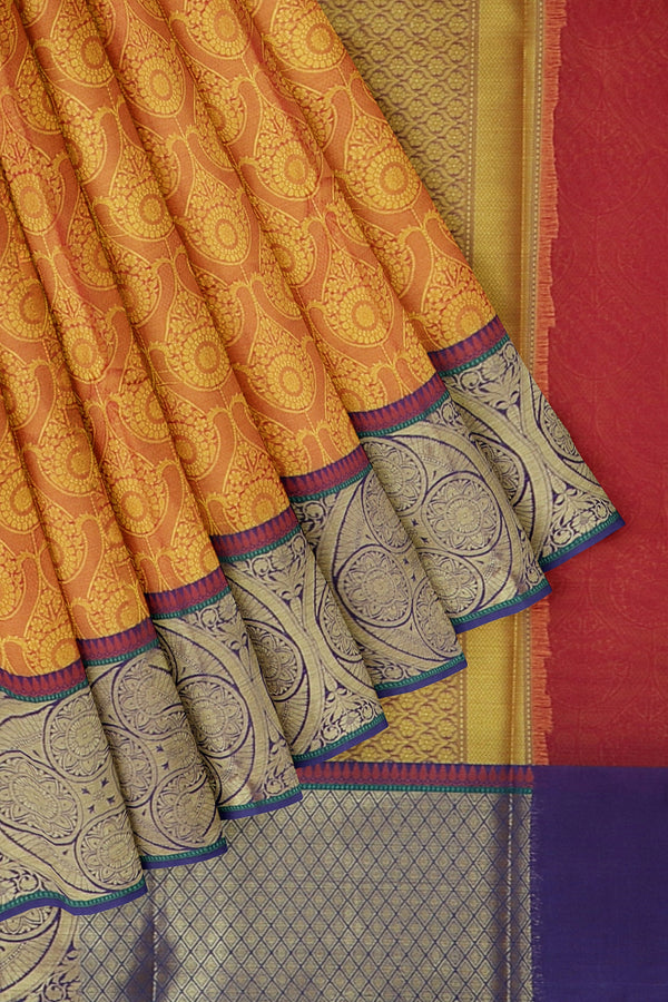 Banarasi Kora golden yellow with blue self embose pattern with kanji style border