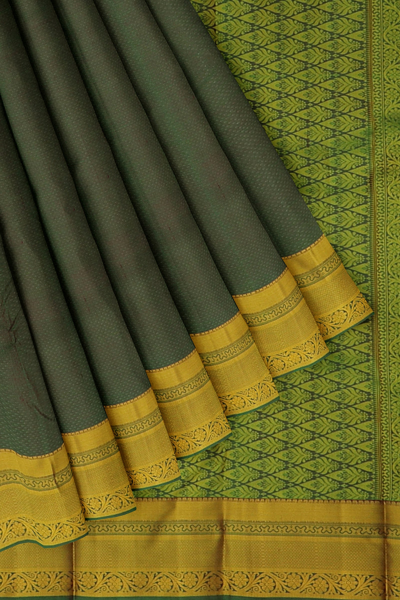 Kanjivaram silk saree dual shade of green with overall self emboss and simple floral thread border