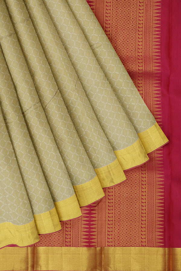 Kanjivaram silk saree dual shade of beige and pink with overall self emboss and golden zari bavanji border
