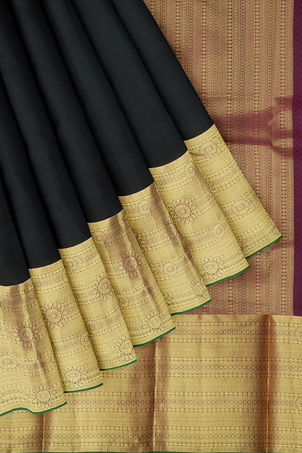 Kanjivaram silk saree black and pink with overall self emboss and golden zari long border