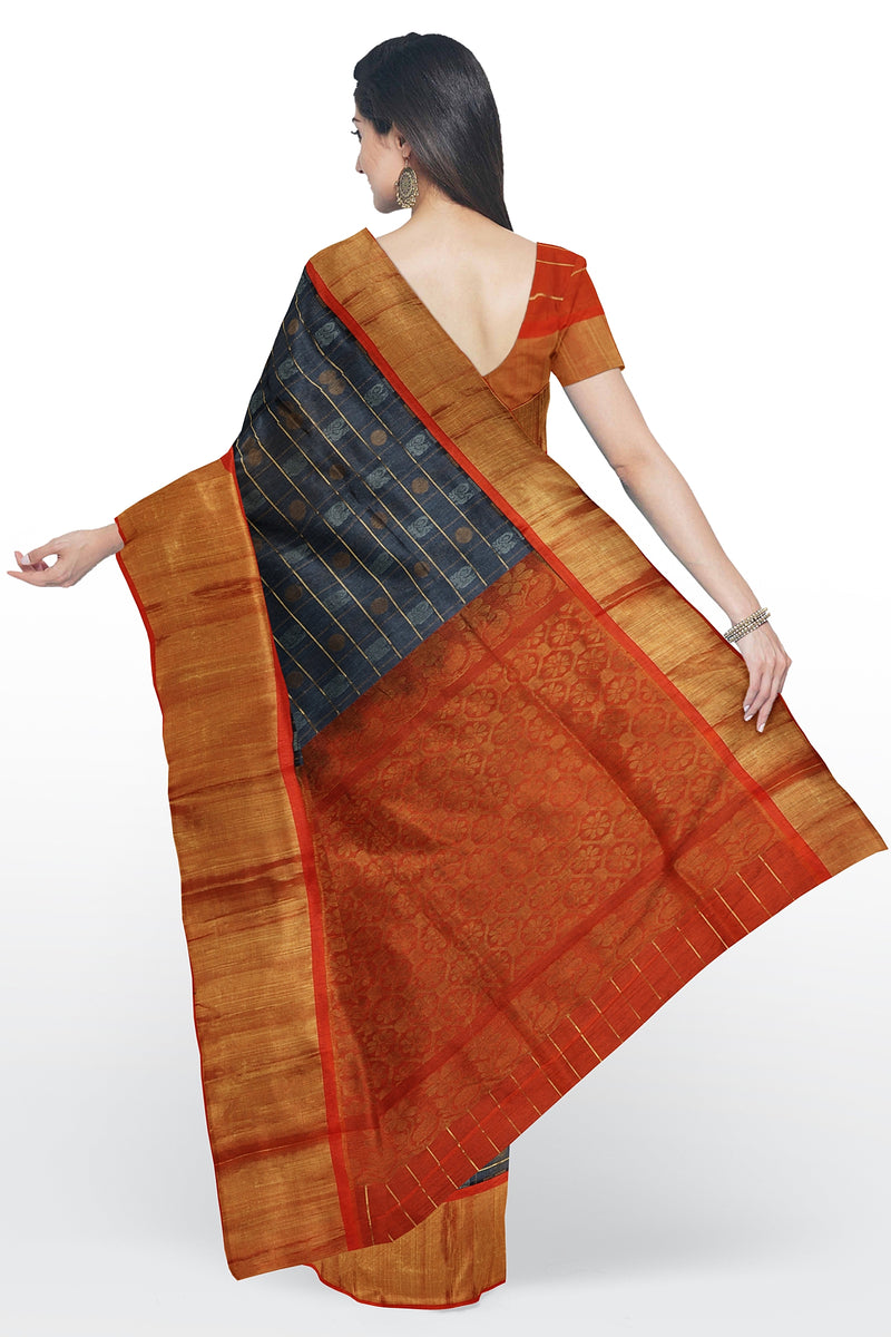 Kuppadam silk cotton saree grey and orange checked pattern with zari buttas and long golden zari border