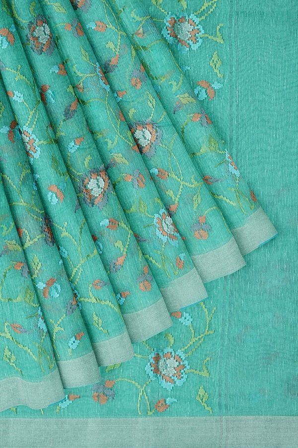 Linen Saree teal with floral computerized embroidery and silver zari border