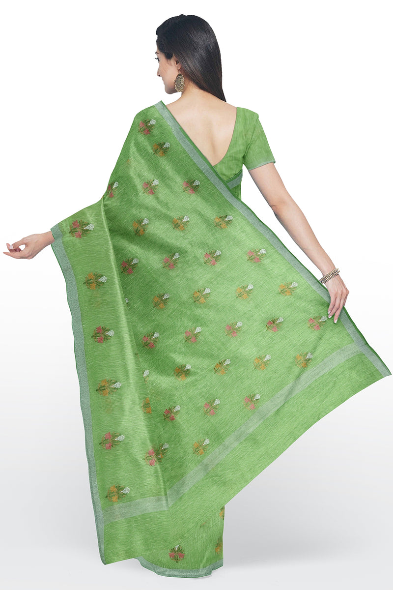 Linen Saree light green with embroidered floral buttas and silver zari border