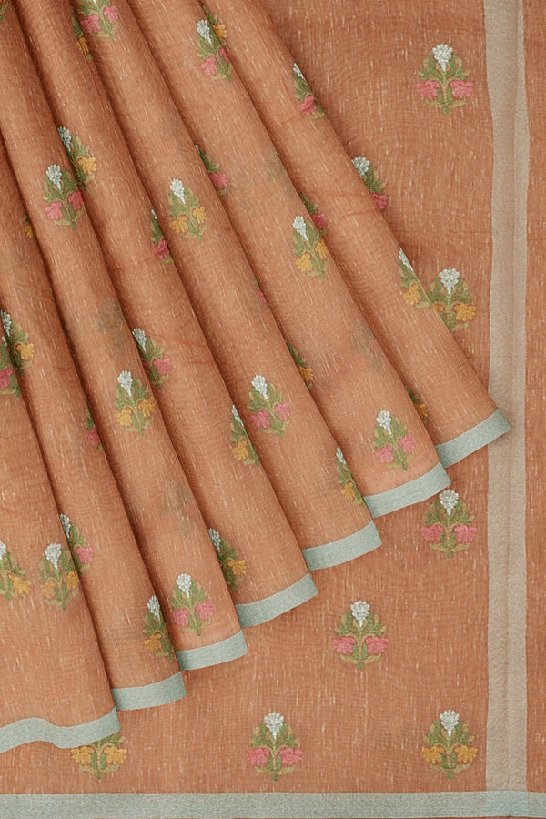 Linen Saree peach with embroidered floral buttas and silver zari border