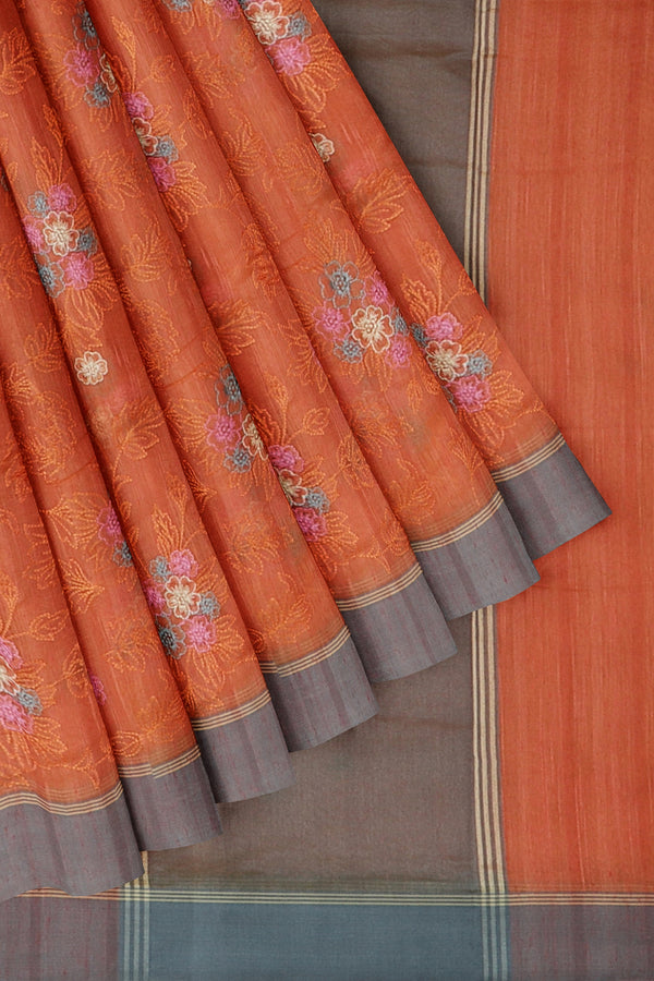 Linen Saree orangish pink with all over floral embroidery and ash border