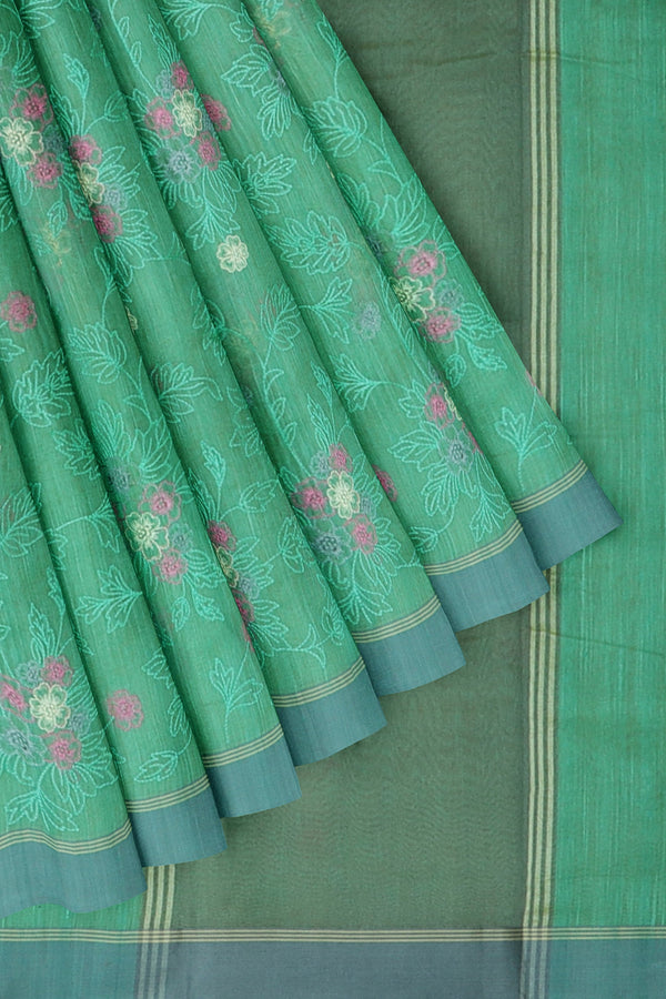 Linen Saree green with all over floral embroidery and ash border
