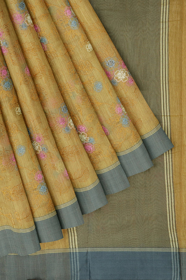 Linen Saree yellow with all over floral embroidery and ash border