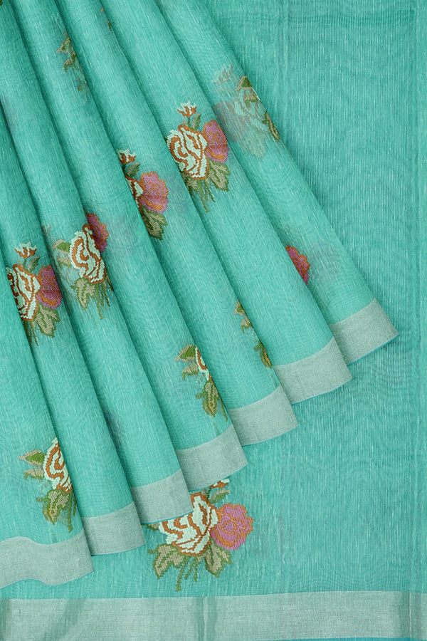 Linen Saree teal with silver zari border and floral embroidered buttas