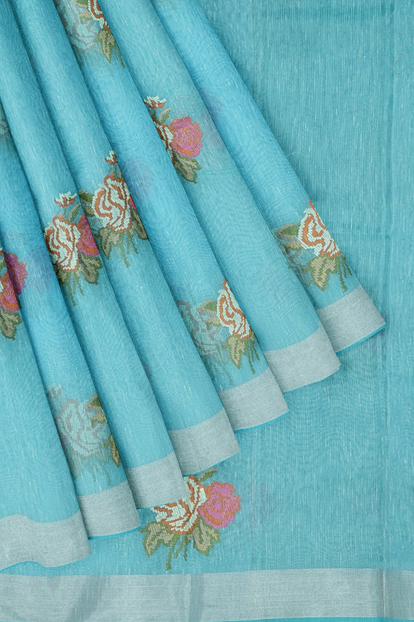 Linen Saree sky blue with silver zari border and floral embroidered buttas