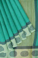 Kota Saree teal with all over print and thread woven satin border
