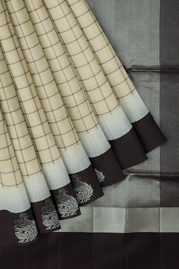 Soft Silk Saree cream and black check body with peacock silver woven motif along the border