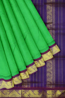 Silk cotton saree green and violet with paisley golden zari temple korvai border