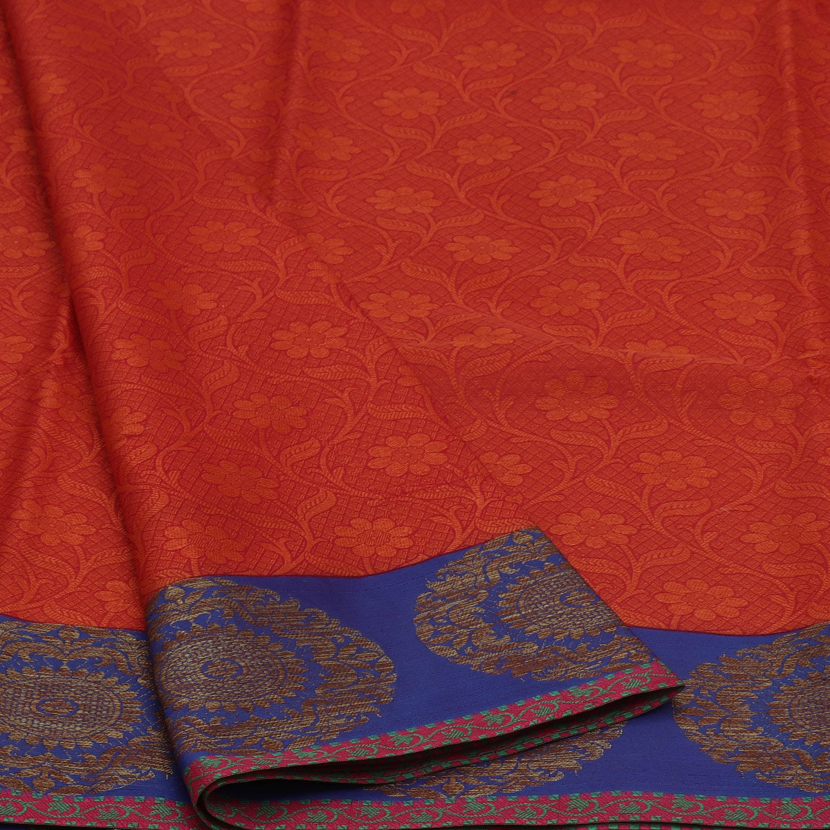 Banarasi Kora Muslin Saree Brick Orange and Blue with Round Flower border