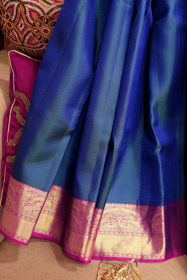 Pure Kanjivaram silk saree dual shade of blue and pink with overall self emboss and golden zari peacock border