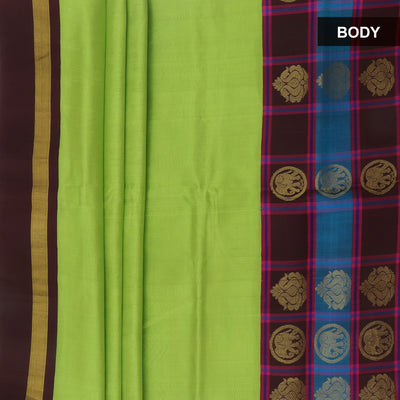 Kuppadam Silk Cotton Saree : Pista green and black with long elephant Silk border