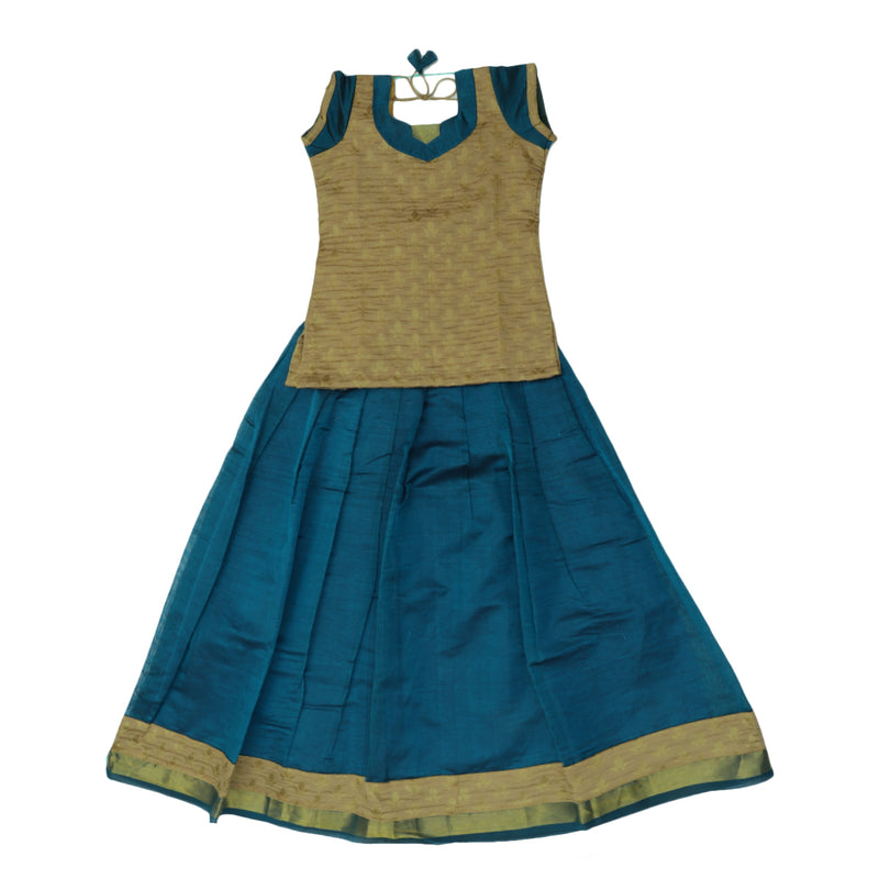 Paavadai Sattai - Beige and Peacock Blue with Wave Zari border ( 9 years)