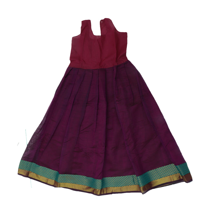 Paavadai Sattai - Green and Purple with Flower and Wave Zari border ( 9 years)