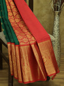 Kuppadam silk cotton saree Bottle green and red with over all zari buttas and long zari peacock temple border
